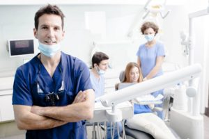 Dentist and dental team helping patient